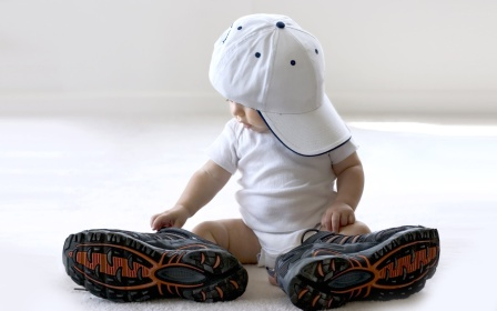 Wearing a pair of big shoes cute baby 2560x1600